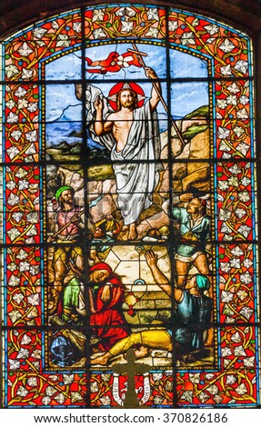 PARIS, FRANCE -  MAY 31, 2015 Jesus Christ Resurrection Stained Glass Basilica Saint Louis En L'ile Church Paris France. Church built in 1726 on the island in back of Nortre Dame.   - stock photo