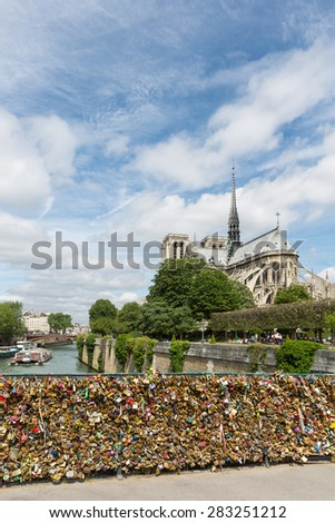 PARIS, FRANCE - MAY 28: Love padlocks representing eternal love of couples who lock padlocks at the bridge Pont de L'Archeveche over the Seine river on May 28, 2015 in Paris, France - stock photo