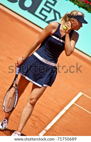 PARIS, FRANCE - MAY 28: Maria Sharapova from Russia prepares to serve during her first round match at Roland Garros on May 28, 2008 in Paris, France. - stock photo