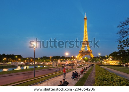PARIS, FRANCE - MAY 17, 2014: Night view of the Eiffel Tower. The tower is the tallest structure in Paris and the most-visited paid monument in the world.