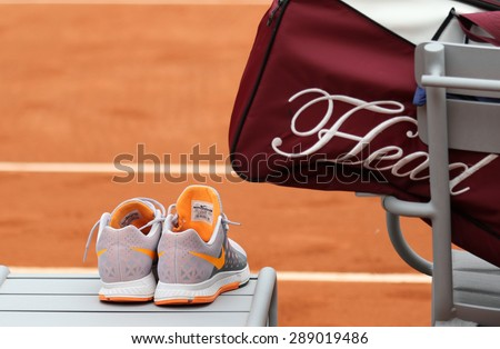 PARIS, FRANCE- MAY 29, 2015: Nike tennis shoes and Head tennis bag at Roland Garros 2015 in Paris, France - stock photo