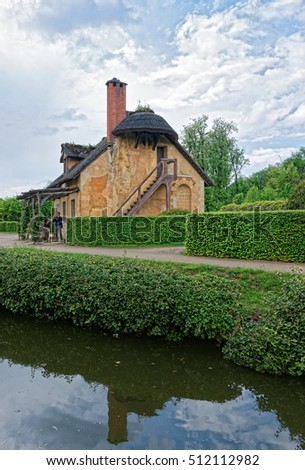 Paris, France - May 5, 2012: Old village of Marie Antoinette at the Palace of Versailles in Paris in France. People on the background