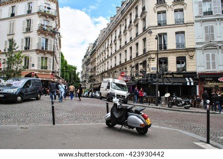 PARIS, FRANCE - MAY 22, 2014: Paris streets. City of Love in France. Street of Paris. Spring in Paris.Paris architecture, people and motorbike