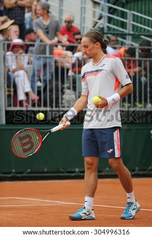 PARIS, FRANCE- MAY 26, 2015: Professional tennis player Alexandr Dologopolov of Ukraine in action his during first round match at Roland Garros 2015 in Paris, France