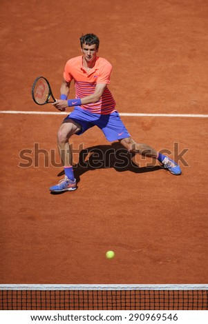 PARIS, FRANCE- MAY 30, 2015 :Professional tennis player Andrey Kuznetsov of Russia in action during his third round match at Roland Garros 2015 in Paris, France