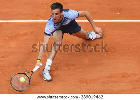 PARIS, FRANCE- MAY 29, 2015: Professional tennis player Damir Dzumhur of Bosnia and Herzegovina during third round match at Roland Garros 2015 in Paris, France