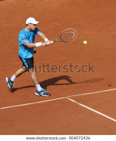 PARIS, FRANCE- MAY 27, 2015: Professional tennis player Diego Schwartzman of Argentina in action during second round match at Roland Garros 2015 in Paris, France - stock photo