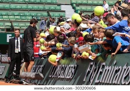 PARIS, FRANCE- MAY 23, 2015: Professional tennis player Gilles Simon of France signing autographs after practice for Roland Garros 2015 in Paris, France - stock photo