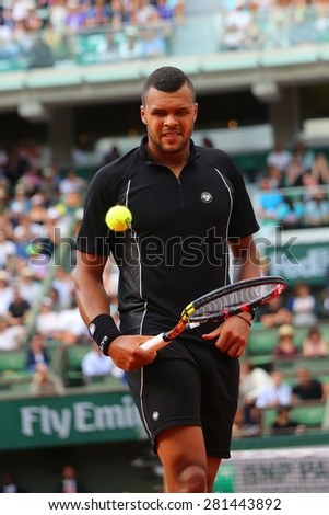 PARIS, FRANCE- MAY 24, 2015: Professional tennis player Jo-Wilfried Tsonga of France during first round match at Roland Garros 2015 in Paris, France - stock photo