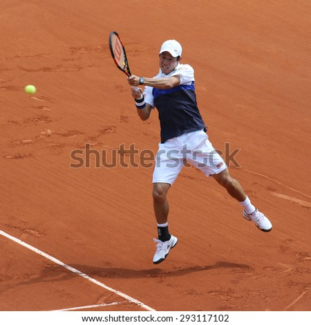 PARIS, FRANCE- MAY 27, 2015: Professional tennis player Kei Nishikori of Japan in action during his second round match at Roland Garros 2015 in Paris, France - stock photo