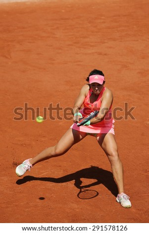 PARIS, FRANCE- MAY 24, 2015: Professional tennis player Louisa Chirico of United States in action during her first round match at Roland Garros 2015 in Paris, France - stock photo