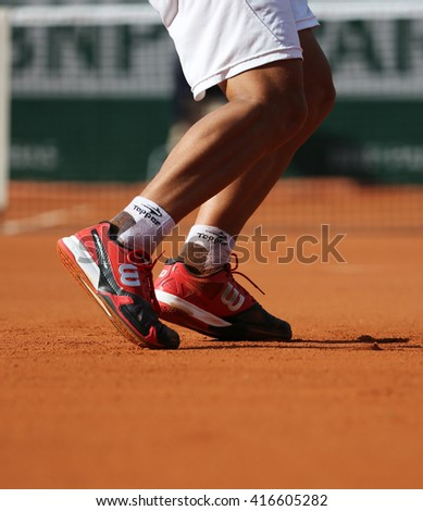 PARIS, FRANCE- MAY 25, 2015: Professional tennis player wears custom Wilson tennis shoes during match at Roland Garros 2015 in Paris, France - stock photo