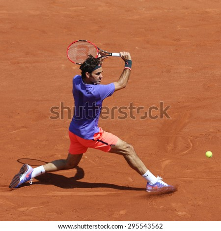 PARIS, FRANCE- MAY 24, 2015: Seventeen times Grand Slam champion Roger Federer in action during his second round match at Roland Garros 2015 in Paris, France - stock photo