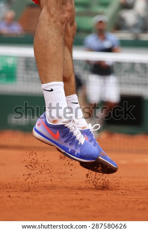 PARIS, FRANCE- MAY 24, 2015:  Seventeen times Grand Slam champion Roger Federer wears custom Nike tennis shoes during third round match at Roland Garros 2015 in Paris, France - stock photo