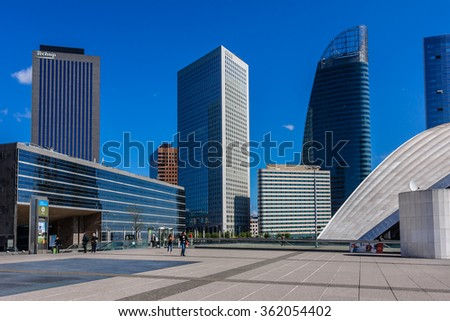PARIS, FRANCE - MAY 15, 2014: Skyscrapers in business district of Defense to the west of Paris. Defense is biggest business district in France and most of large companies have offices here. - stock photo