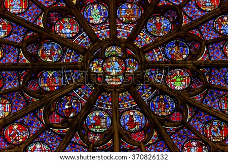 PARIS, FRANCE -  MAY 31, 2015 South Rose Window Jesus Disciples Stained Glass Notre Dame Cathedral Paris France.  Notre Dame was built between 1163 and 1250 AD.   - stock photo