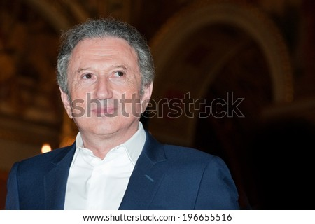 Paris, FRANCE - MAY 31, 2011 - The TV presenter Michel Drucker during the operation, 2000 women for 2012, in city hall Paris - stock photo