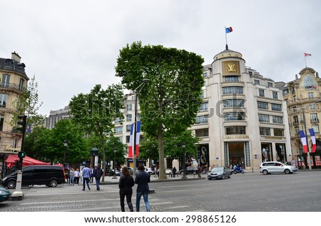 Paris, France - May 14, 2015: Tourists Shopping at Louis Vuitton store on May 14, 2015 in Paris, France. This store offers a wide range of luxury Louis Vuitton clothes and accessories - stock photo