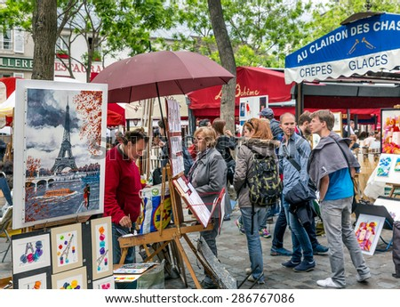 PARIS, FRANCE - May 28: Tourists visiting Place du Tertre in Montmartre, one of the most touristic attractions of the city, on May 28, 2015, Paris, France - stock photo