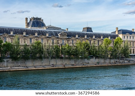 PARIS, FRANCE - MAY 30, 2015: View of famous Louvre Museum from the Seine River. Louvre Museum is one of the largest and most visited museums worldwide.  - stock photo