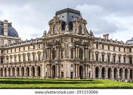 PARIS, FRANCE - MAY 13, 2014: View of Louvre building at courtyard of Louvre Museum. Louvre Museum is one of the largest and most visited museums worldwide. - stock photo
