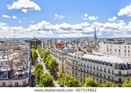 Paris, France - May 20, 2015: view to the Rue Tronchet , Church of St. Mary Magdalene  and Eiffel tower - stock photo