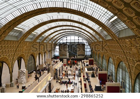 Paris, France - May 14, 2015: Visitors in the Musee d'Orsay in Paris, France. on May 14, 2015, Museum houses the largest collection of impressionist and post-impressionist masterpieces in the world. - stock photo