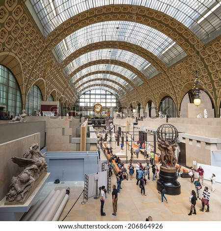 PARIS, FRANCE - MAY 17, 2014: Visitors in the Musee d'Orsay. Opened in 1986, it houses the largest collection of impressionist and post-impressionist masterpieces in the world. - stock photo