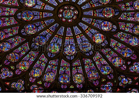 PARIS, FRANCE - MAY 31, 2015 White Mary Jesus Christ Stained Glass Notre Dame Cathedral Paris France.  Notre Dame was built between 1163 and 1250 AD.   - stock photo