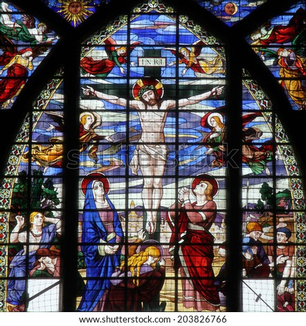PARIS, FRANCE - NOV 09, 2012: Crucifixion, Jesus on the cross, stained glass. Church of Saint-Jean-de-Montmartre situated at the foot of Montmartre. Built from 1894 through 1904, Nov 09, 2012 in Paris - stock photo