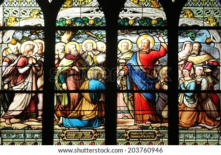 PARIS,FRANCE - NOV 11,2012:Jesus gives Peter the keys to the Kingdom, stained glass.The Church of St Severin is Catholic church in the Latin Quarter. It is one of the oldest churches on the Left Bank. - stock photo