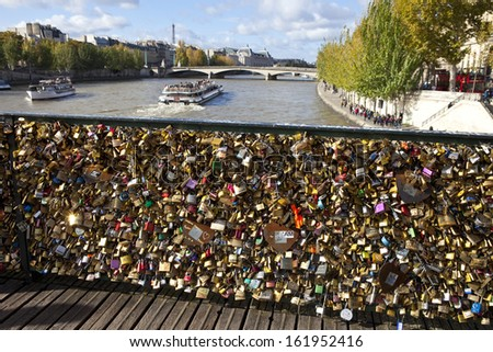 PARIS, FRANCE - NOV 3RD 2013: The Love Padlocks on Pont des Arts in Paris on 3rd November 2013. - stock photo