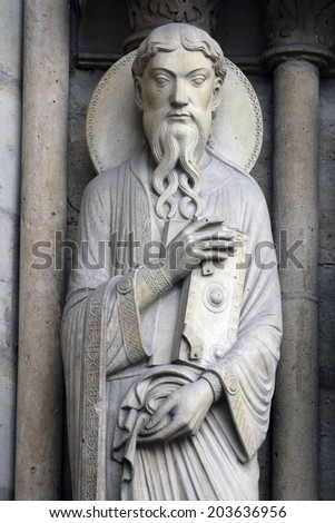 PARIS, FRANCE - NOV 05, 2012: Saint Paul, architectural detail of Notre Dame cathedral. Portal of St. Anne.
