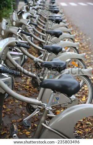 PARIS, FRANCE - NOVEMBER 22, 2014: A row of rental bicycles for hire, called Velib, in Paris - stock photo