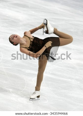 PARIS, FRANCE - NOVEMBER 16, 2013: Adelina SOTNIKOVA of Russia performs free program at Trophee Bompard ISU Grand Prix at Palais Omnisports de Bercy. - stock photo