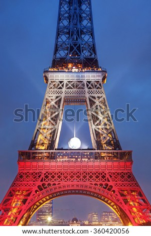 PARIS, FRANCE - NOVEMBER 20, 2015: Eiffel tower illuminated with colors of French national flag after November 13 Friday's terrorist attacks.