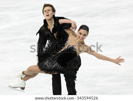 PARIS, FRANCE - NOVEMBER 16, 2013: Elena ILINYKH / Nikita KATSALAPOV of Russia perform free dance at Trophee Bompard ISU Grand Prix at Palais Omnisports de Bercy. - stock photo