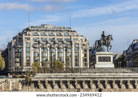"PARIS, FRANCE - NOVEMBER 12, 2014: Embankment of Seine River and building of famous store ""La Samaritaine"". Store was first opened in 1869 by Ernest Cognacq and Marie-Louise Jay. - stock photo"