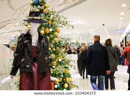 PARIS, FRANCE - NOVEMBER 23, 2014: Interior of  Printemps department store decorated for the Christmas season. Printemps is one of well-known Parisian department store located on Boulevard Haussmann. - stock photo