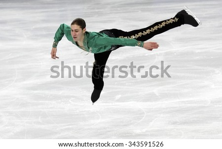 PARIS, FRANCE - NOVEMBER 16, 2013: Jason BROWN of USA performs free program at Trophee Bompard ISU Grand Prix at Palais Omnisports de Bercy. - stock photo