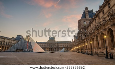 PARIS, FRANCE - 29 NOVEMBER, 2014: Louvre in the sunrise. The pyramid - stock photo
