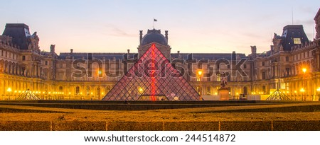 PARIS, FRANCE  29 NOVEMBER, 2014: Louvre in the sunrise. The pyramid - stock photo