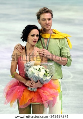 PARIS, FRANCE - NOVEMBER 16, 2013: Nathalie PECHALAT / Fabian BOURZAT of France pose during the victory ceremony in ice dance at Trophee Bompard ISU Grand Prix at Palais Omnisports de Bercy. - stock photo