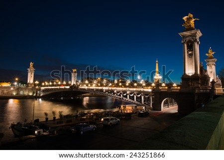 PARIS, FRANCE -  NOVEMBER 9, 2014 Night view on iluminated Alexander III bridge and Eiffel Tower in Paris , France - stock photo