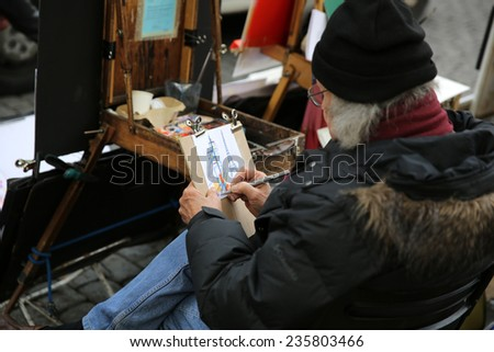 PARIS, FRANCE - NOVEMBER 21, 2014: Open Air Artist Market at Tertre Square (Place du Tertre) in Montmartre - stock photo