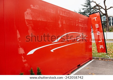 PARIS, FRANCE - NOVEMBER 29, 2014: Tesla showroom has arrived in Paris, France. Tesla is an American company that designs, manufactures, and sells electric cars - stock photo