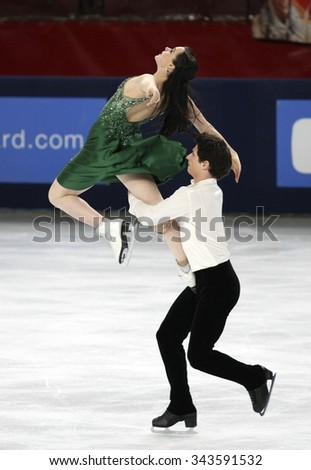 PARIS, FRANCE - NOVEMBER 16, 2013: Tessa VIRTUE / Scott MOIR of Canada perform free dance at Trophee Bompard ISU Grand Prix at Palais Omnisports de Bercy. - stock photo