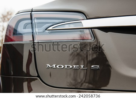 PARIS, FRANCE - NOVEMBER 29, 2014: The Tesla Motors Inc. rear view of the advanced led rear-lights of the Model S electric vehicle displayed at the company's showroom in Paris, France - stock photo