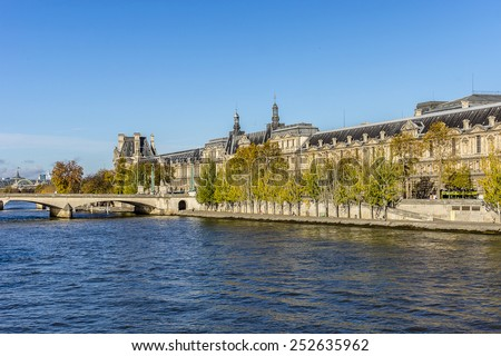 PARIS, FRANCE - NOVEMBER 12, 2014: View of famous Louvre Museum from the Seine river. Louvre Museum is one of the largest and most visited museums worldwide. - stock photo