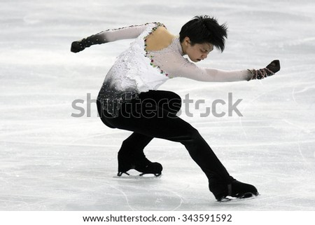PARIS, FRANCE - NOVEMBER 16, 2013: Yuzuru HANYU of Japan performs free program at Trophee Bompard ISU Grand Prix at Palais Omnisports de Bercy. - stock photo